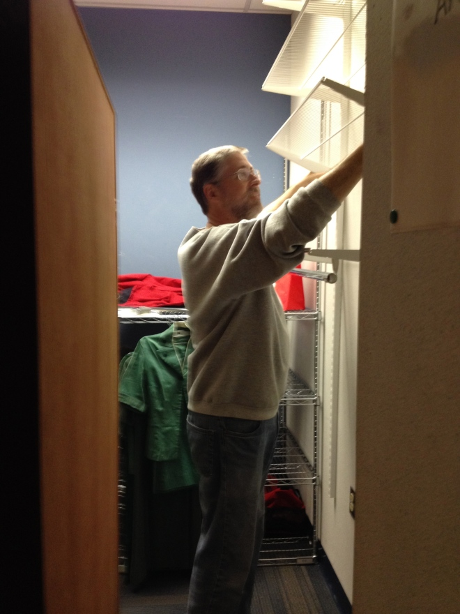 Mark is an expert with Elfa shelving. (Really. You should see our closets at home!)