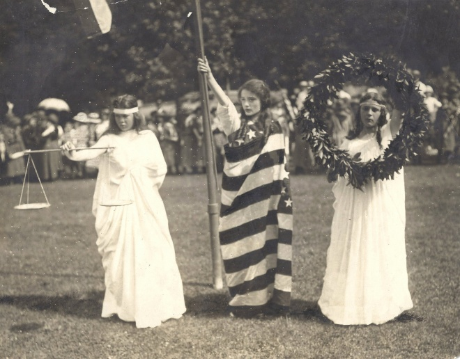 Girl Scouts representing Justice, Liberty, and Peace strike a pose during a June 19, 1915, rally at the National Zoo in Washington, DC.