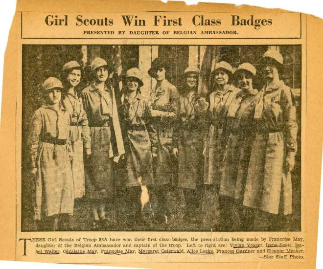Françoise presents the First Class rank to her sister Ghislane and other members of Troop 53.