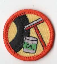Junior Car Care badge orange