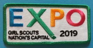 Green bordered patch reading Expo 2019, Girl Scouts Nation's Capital